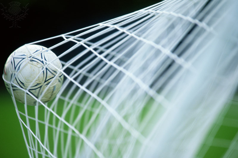 Soccer ball in net, close-up (Photo by Ian Walton/Getty Images) / Universal Images Group Rights Managed / For Education Use Only